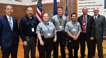 (L to R): Nebraska State College System Chancellor Dr. Paul Turman, Tecumseh State Correctional Institution Warden Todd Wasmer, Peru State College Officer Intern Cherise Womelsdorf, Peru State College Officer Intern Gabriel Stolinski, Peru State College Officer Intern Paw Wah, Nebraska Department of Correctional Services Director Scott R. Frakes, Peru State College President Dr. Michael Evans