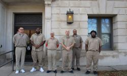Incarcerated men at WEC who received first state IDs in new program.